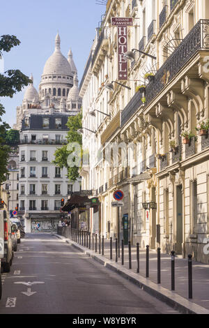 Paris Montmartre street - afternoon sunlight at Place d'Anvers with a view of the Sacre Coeur basilica in Montmartre, Paris, France, Europe. - Stock Photo