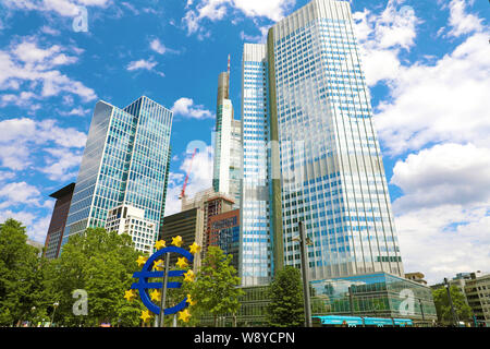 Giant Euro sign and EZB European Central Bank building in