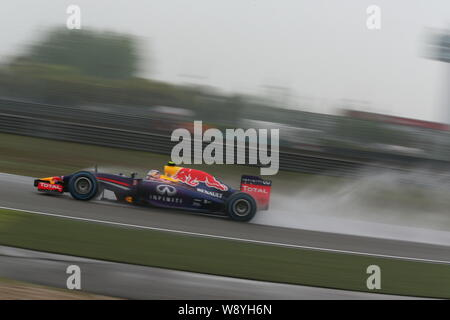 Australian F1 driver Daniel Ricciardo of Infiniti Red Bull Racing competes during the qualifying session of the 2014 Formula 1 Chinese Grand Prix at t - Stock Photo