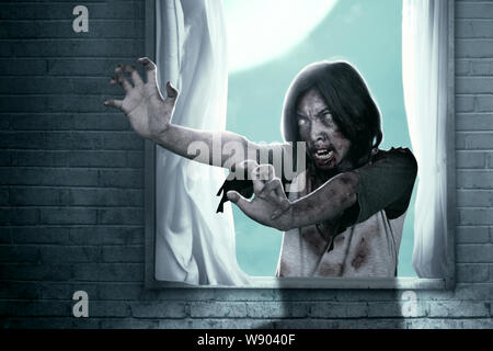 Scary zombies with blood and wound on his body haunted the abandoned house. Halloween concept - Stock Photo