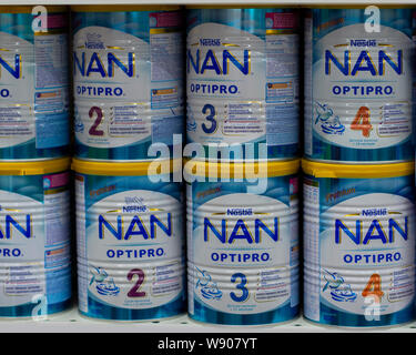 03-08-2019 Moscow, Russia. Baby food milk formula NAN Nestle in large white blue metal cans on a store shelf. Dry mix for feeding young children - Stock Photo
