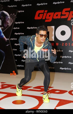 Hong Kong singer and actor Aaron Kwok poses during a launch event for the 2014 GigaSports 10-Kilometer Race in Hong Kong, China, 24 September 2014. - Stock Photo