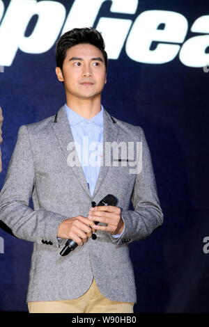 Former Chinese Olympic diving champion Tian Liang poses at the launch event for the reality TV show 'Top Gear' in Shanghai, China, 12 November 2014. - Stock Photo