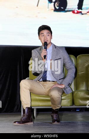 Former Chinese Olympic diving champion Tian Liang speaks at the launch event for the reality TV show 'Top Gear' in Shanghai, China, 12 November 2014. - Stock Photo