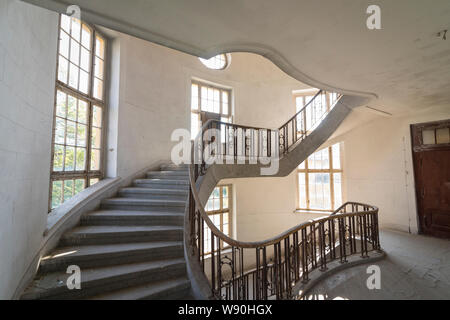 Stairway at interior of former historical barracks, officers building 'Haus der Offiziere', abandoned by the Russian army in 1994 - Stock Photo