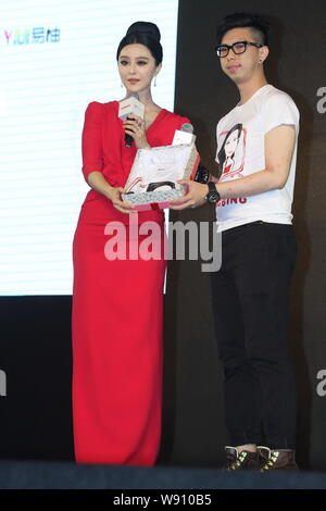 Chinese actress Fan Bingbing, left, poses with a fan during a promotional event for Konka Slim TV in Chengdu city, southwest Chinas Sichuan province, - Stock Photo