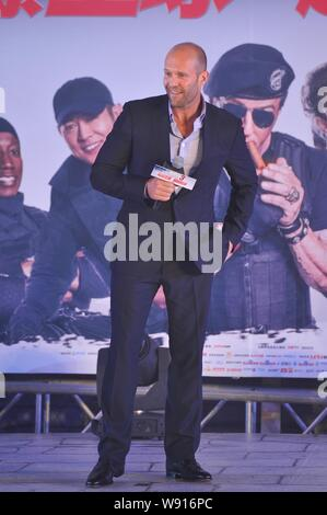 British actor Jason Statham smiles during a press conference for his new movie, The Expendables 3, in Beijing, China, 1 August 2014. - Stock Photo