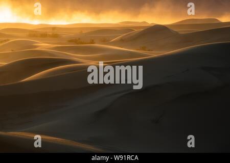Sandstorm at sunset, Mesquite Dunes, Death Valley National Park, California
