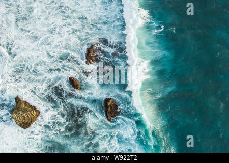 Aerial view of crashing waves on rocks. View from above, drone photo, beautiful nature background - Stock Photo