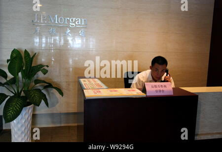 --FILE--A Chinese employee works at a branch of JP Morgan in Suzhou city, east Chinas Jiangsu province, 21 July 2012.   J.P. Morgan Chase & Co. has wi - Stock Photo