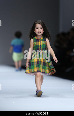 A young model displays a new creation at the Kelkel fashion show during the Shanghai Fashion Week Spring/Summer 2014 in Shanghai, China, 20 October 20 - Stock Photo