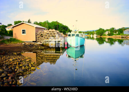 Fishing boat and lobster traps in a harbor on Cape Breton. - Stock Photo