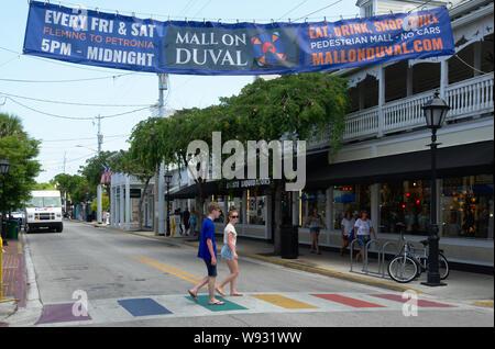 Rainbow cross roads on Duval Street, Key West, Florida. - Stock Photo