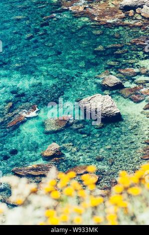 Beautiful blue turquoise sea water with rocks, looking like a lagoon, of the mediterannean coast of Bonifacio, Corsica - Stock Photo