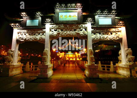 --FILE--Night view of a bridge on the Nanming River in Guiyang, southeast Chinas Guizhou province, 10 August 2008.   A credit-fuelled investment spree - Stock Photo