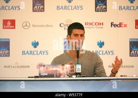 Serbian tennis player Novak Djokovic speaks during a press conference of the ATP World Tour Finals in London, UK, 4 November 2013. - Stock Photo
