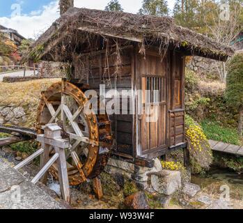 Water mill in the old post town of Tsumago (Tsumago-juku), Nagiso, Kiso District, Nagano Prefecture, Japan - Stock Photo