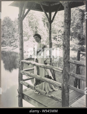 Actress Julia Marlowe standing on a platform above a lake / Burr McIntosh Studio, 18 West 33rd Street - Stock Photo