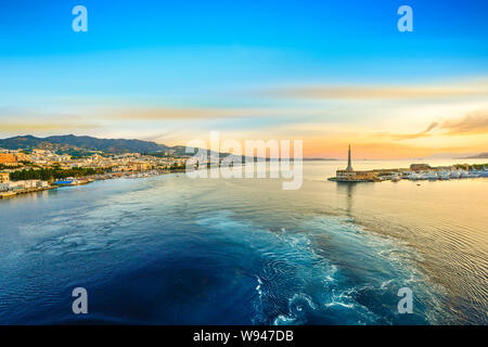 Sunrise from a cruise ship at the port of Messina, Italy on the island of Sicily in the Mediterranean Sea - Stock Photo