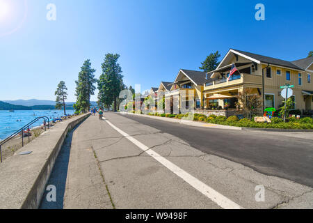 A waterfront high end luxury townhome complex across the street from Lake Coeur d'Alene, in the mountain resort city of Coeur d'Alene, Idaho. - Stock Photo