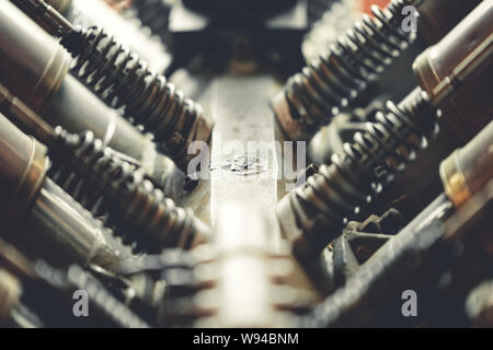 Inside of an old V8 engine used in Vehicles and Airplanes showing the Cylinders, valves and springs - Stock Photo