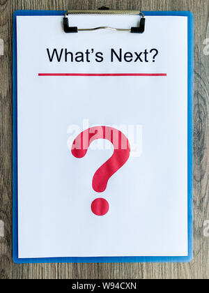 Clipboard with text what's next on wood desk. - Stock Photo
