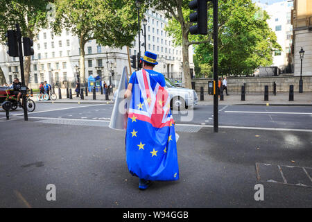 Pro European, anti-Brexit protester Steven Bray, Westminster's Stop Brexit Man walks with flags and placards, London - Stock Photo