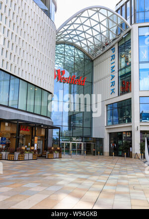 Exteropr view of Westfield Shopping Centre facade and entrance with logo and sign, White City, West London, UK - Stock Photo
