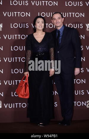 e107ccab8b3 Chinese actress Gong Li, left, poses with Philippe Fortunato ...