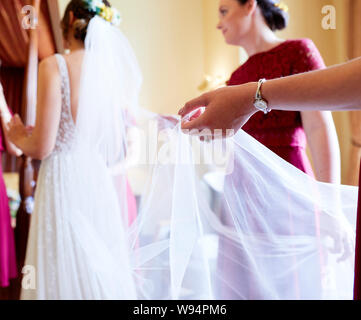 Bride getting ready before her wedding - Stock Photo