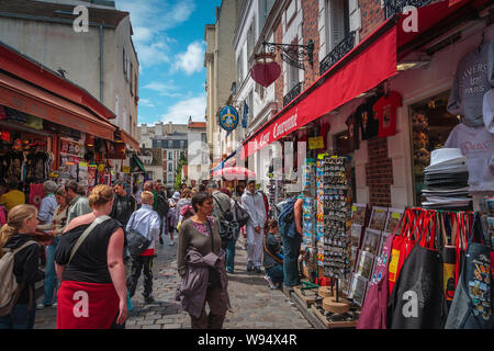 Montmartre, Paris - Busy souvenir shopping area crowded with tourists - Stock Photo