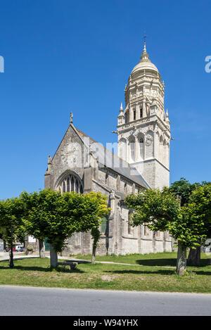 11th century church of Notre-Dame de l'Assomption in the village Sainte-Marie-du-Mont, Manche, Normandy, France - Stock Photo