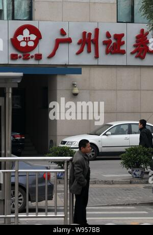 --File--Pedestrians walk past a branch of Guangzhou Securities in Beijing, China, 25 September 2010.   Chinas securities regulator has approved the es - Stock Photo