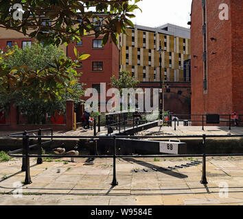 Safety fencing recently installed to deter people from crossing the lock gates on Tib Lock on The Rochdale canal in central Manchester. - Stock Photo
