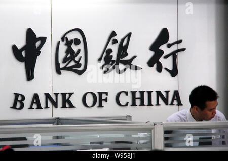 --FILE--A Chinese employee works at a branch of Bank of China (BOC) in Nantong city, east Chinas Jiangsu province, 23 July 2012.   Bank of China Ltd., - Stock Photo