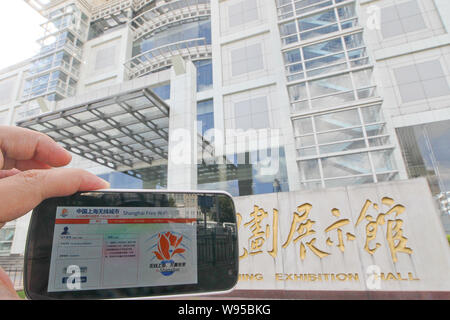 A smartphone screen at Shanghai Urban Planning Exhibition Hall shows the login page of the Wi-Fi service i-Shanghai in Shanghai, China, 30 July 2012. - Stock Photo