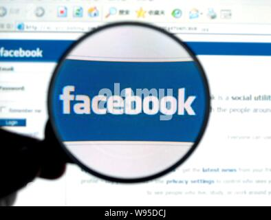 --File--A Chinese netizen browses the website of Facebook in Shaoyang, central Chinas Hunan province, 23 January 2011.   Chinas internet users have be - Stock Photo