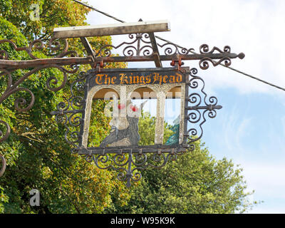 A view of the former King's Head Inn sign outside The Orange Tree restaurant in the village of Thornham, Norfolk, England, United Kingdom, Europe. - Stock Photo