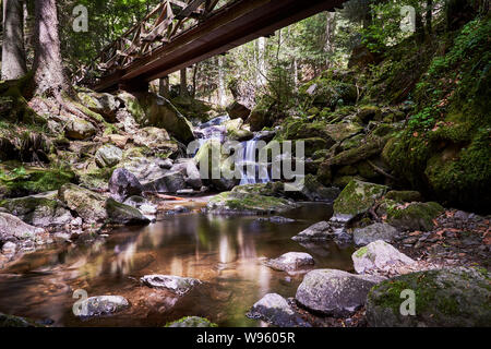 Small waterfall, a wooden bridge and nature at the Ravenna canyon / Ravennaschlucht in the Black Forest, Germany / 2018 - Stock Photo