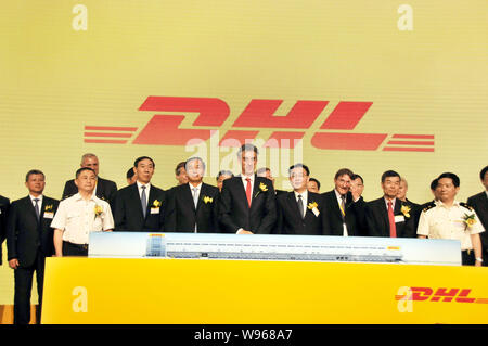 Deutsche Post DHL Chairman of the Board of Management and CEO Frank Appel (C) is pictured with his colleagues during the opening ceremony of the compa - Stock Photo
