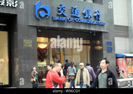 --File--Pedestrians walk past a branch of Bank of Communications (BoCom) in Chongqing, China, 28 March 2012.   Bank of Communications has got approval - Stock Photo