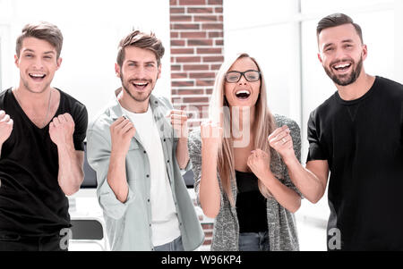 portrait of youth guys victoriously raising their fists up and rejoicing - Stock Photo