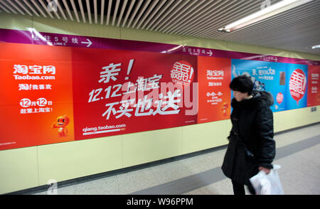 --File--A pedestrian walks past an advertisement for Taobao.com in Beijing, China, 6 December 2011.   A number of employees at Taobao, Chinas largest - Stock Photo