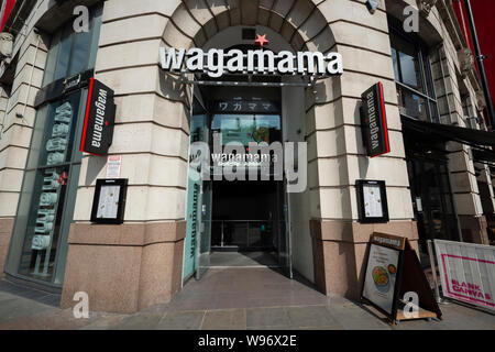 The Wagamama Japanese cuisine restaurant located in the Printworks in Manchester City Centre. - Stock Photo