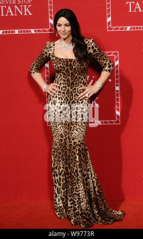 Italian actress Monica Bullucci poses during the Cartier Never Stop Tank new watch releasing activity in Shanghai,  China, 6 July 2012. - Stock Photo