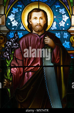 A stained-glass window depicting Saint Joseph. Displayed at the Bishop's office. - Stock Photo