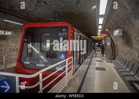 LYON, FRANCE - JULY 19, 2019: Lyon Funicular Railway train entering the station of St Just with tourists preparing to enter, before bringing them to V - Stock Photo