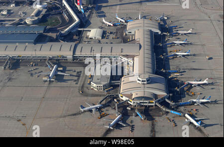 --FILE--Aerial view of jet planes at the Terminal 1 of the Beijing Capital International Airprot in Beijing, China, 17 January 2011.   The Beijing Cap - Stock Photo