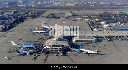 --FILE--Aerial view of jet planes at the Terminal 2 of the Beijing Capital International Airport in Beijing, China, 17 January 2011.   Beijing Capital - Stock Photo
