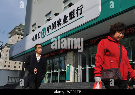 --File--Pedestrians walk past a branch of Agricultural Bank of China (ABC) in Lanzhou, northwest Chinas Gansu province, 15 October 2011.    Agricultur - Stock Photo